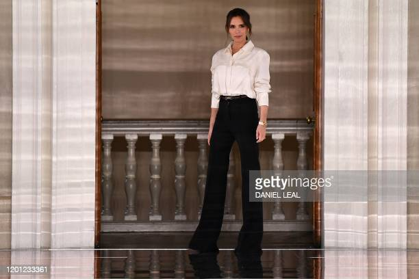 British fashion designer Victoria Beckham reacts after presenting creations for her Autumn/Winter 2020 collection on the third day of London Fashion...