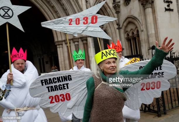 TOPSHOT British fashion designer Vivienne Westwood dressed as an angel poses with other antifracking activists dressed as Joseph and the three wise...