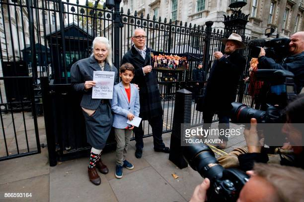 British fashion designer Vivienne Westwood her son Joe Corre and nineyearold Oliver Simpson who has written to the Prime Minister to protest against...