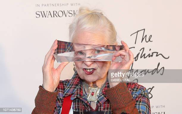 TOPSHOT British fashion designer Vivienne Westwood poses with their award for Positive Change during the British Fashion Awards 2018 in London on...