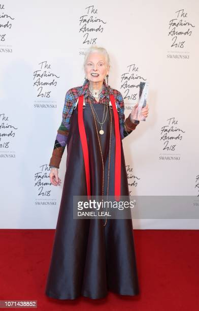 British fashion designer Vivienne Westwood poses with their award for Positive Change during the British Fashion Awards 2018 in London on December 10...