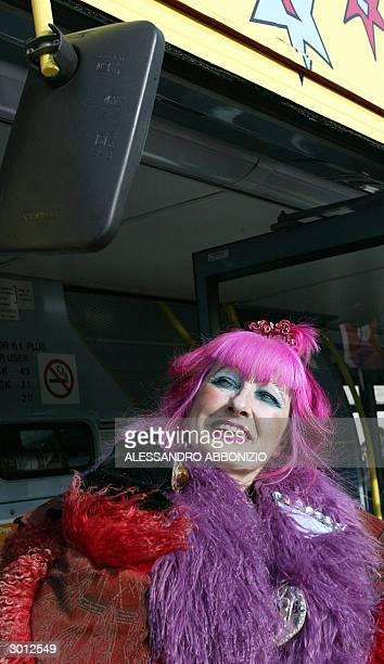 British fashion designer Zandra Rhodes admires herself 25 February 2004 in a mirror of a bus that she designed for public service in the capital AFP...