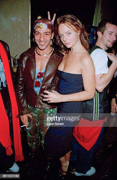 British fashion designers John Galliano and Stella McCartney at a party for the documentary film 'The Clash Westway to the World' at the Cobden Club...