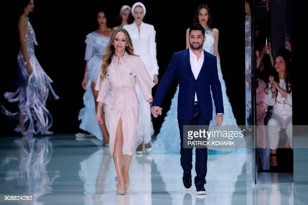 British fashion designers Michael Russo and Tamara Ralph for Ralph Russo acknowledge the audience after the Ralph Russo's fashion show during the...