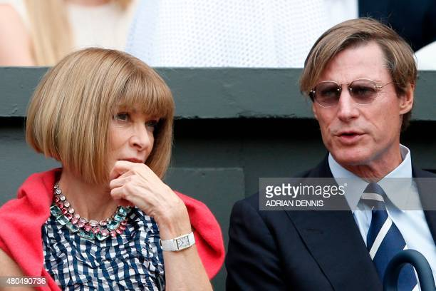 British fashion editor Anna Wintour and her partner Shelby Bryan sit on Centre Court to watch the men's singles final match between Serbia's Novak...