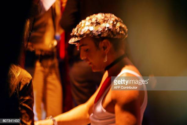British fashion John Galliano is seen backstage, 20 January 2003 in Paris prior the presentation of Christian Dior Spring-Summer 2003 Haute Couture...