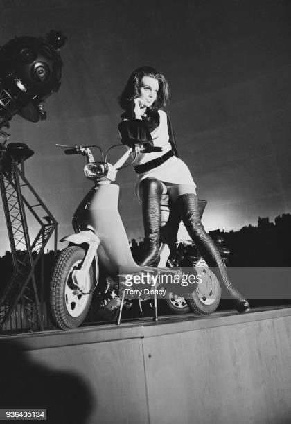 British fashion model Diana Bailey poses with the new Lambretta scooter at the London Planetarium UK 26th November 1968