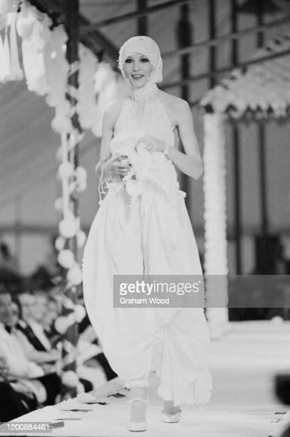 British fashion model Paulene Stone walking on the catwalk at a fashion show Uk 10th June 1976