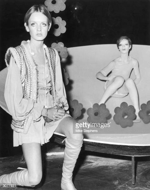 British fashion model Twiggy compares herself to her waxwork at Madame Tussauds 3rd October 1967 The figure is part of a new exhibition entitled...