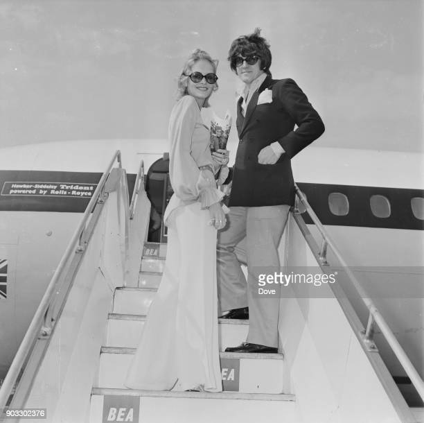 British fashion model Twiggy with her partner and manager Justin de Villeneuve at Heathrow Airport London UK 26th August 1968