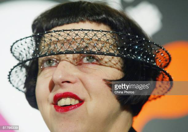 British fashion stylist Isabella Blow displays her new hat during the 2004 Lycra Channel Young InStyle Awards on November 26 2004 in Shanghai China
