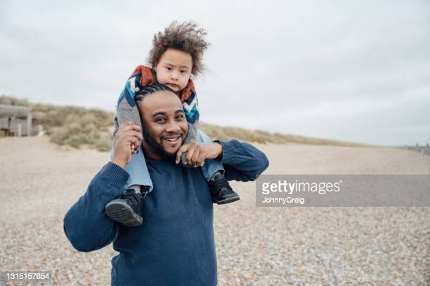 british father and young son vacationing at camber sands - disability stock pictures, royalty-free photos & images