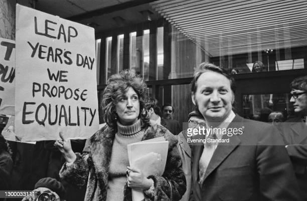 British feminist and activist Jill Tweedie and German-born British journalist William Davis during a protest, UK, 1st March 1972. Tweedie is holding...