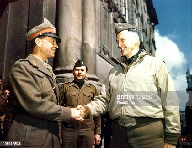 British Field Marshal Harold Alexander 1st Earl Alexander of Tunis commander of Allied Armies in Italy shakes hands with American Brigadier General...