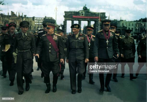 British Field Marshall Bernard Montgomery leaves the Brandenburg Gate after a ceremony to decorate Soviet Generals Berlin 12th July 1945 With him are...