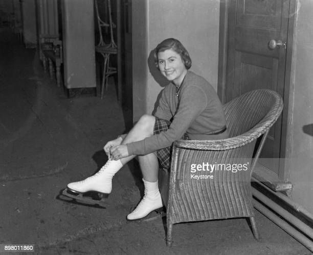 British figure skating champion Cecilia Colledge puts on her skates before a training session 26th October 1942 She is practising for an exhibition...