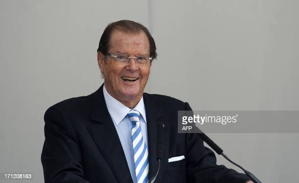 British film actor Roger Moore speaks at a memorial to the late film director and restaurant critic Michael Winner at the National Police Memorial in...
