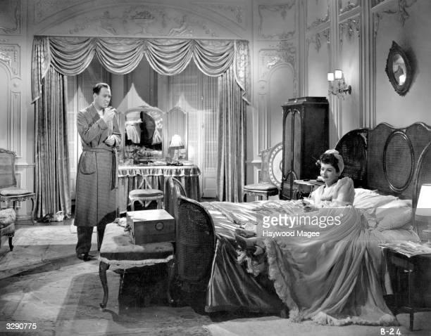 British film actors Margaret Lockwood and Ian Hunter in a bedroom scene from the GFD film 'Bedelia' directed by Lance Comfort Original Publication...