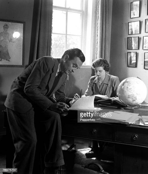 1951 British film actress Ann Todd and her producer/director husband David Lean are pictured at their Kensington home