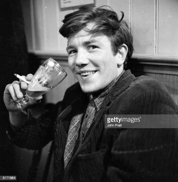 British film and stage actor Albert Finney enjoying a glass of beer in his regular pub behind the Cambridge Theatre in London