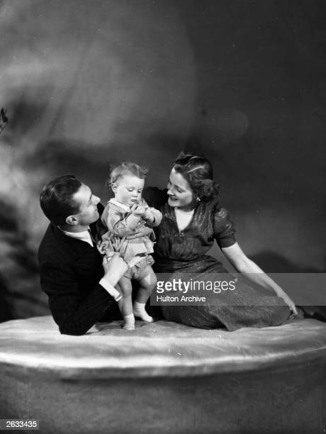 British film and stage actor Michael Redgrave with his wife Rachel Kempson and baby Vanessa Original Publication People Disc HK0140