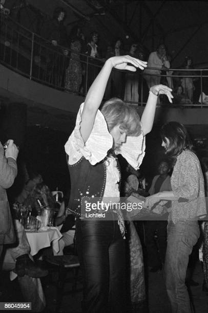British film and stage actress Julie Christie dancing at the reception at the Cafe des Arts following the wedding of British rock musician Mick...