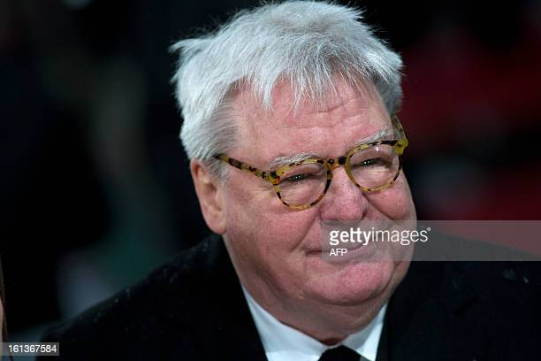 British film director Alan Parker poses on the red carpet upon arrival to attend the annual BAFTA British Academy Film Awards at the Royal Opera...
