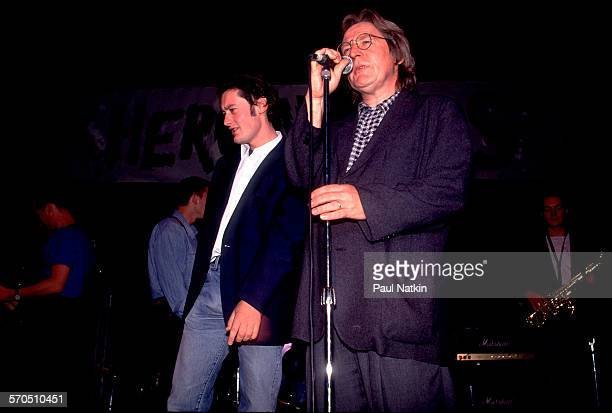 British film director Alan Parker with Irish actor and musician Robert Arkins speaks at a premiere party for their film 'The Commitments' at the Park...