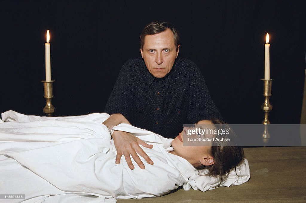 British film director Peter Greenaway with a young woman wrapped in a shroud on the set of his film 'Death in the Seine', October 1989.