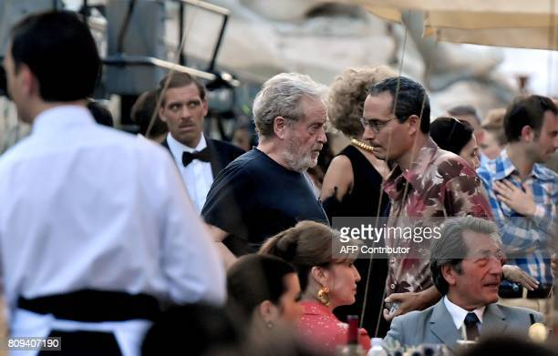 British film director Ridley Scott speaks with a man on the set of his new movie 'All the money in the world' at Piazza Navona in central Rome on...