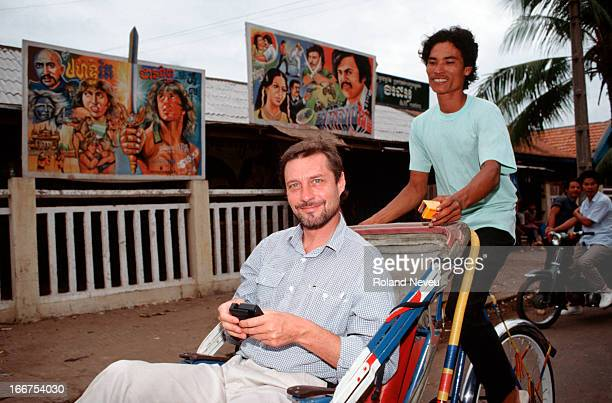 British film director Roland Joffe takes a cyclo ride during one of his visits to Phnom Penh He is wellknown for his awardwinning first movie 'The...