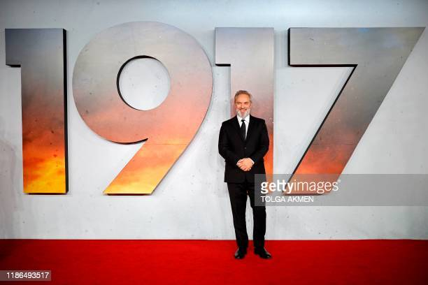"""British film director Sam Mendes poses on the red carpet as he arrives to attend the World premiere and Royal Film Performance of the film """"1917"""" in..."""