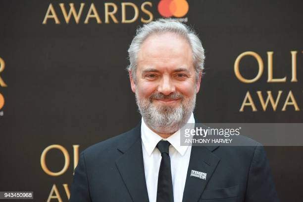 British film director Sam Mendes poses on the red carpet upon arrival to attend The Olivier Awards at the Royal Albert Hall in central London on...