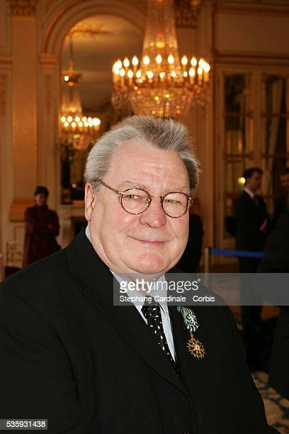 British film director Sir Alan Parker displays his Officier des Arts et Lettres medal awarded to him for his contribution to cinema