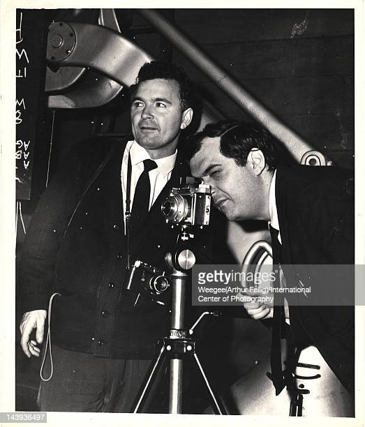 British film director Stanley Kubrick looks through a camera, England, ca. 1963.