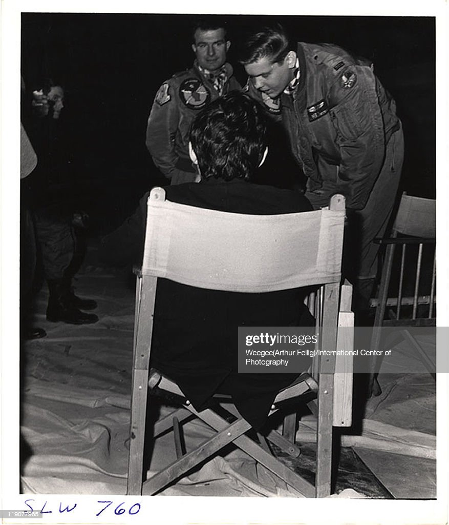 British film director Stanley Kubrick (1928 - 1999) (sitting fore) speaks with two, unidentified actors during the filming of his movie, 'Dr. Strangelove, Or How I Learned to Stop Worrying and Love the Bomb' at Shepperton Studios, Shepperton, England, 1963. (Photo by Weegee(Arthur Fellig)/International Center of Photography/Getty Images)