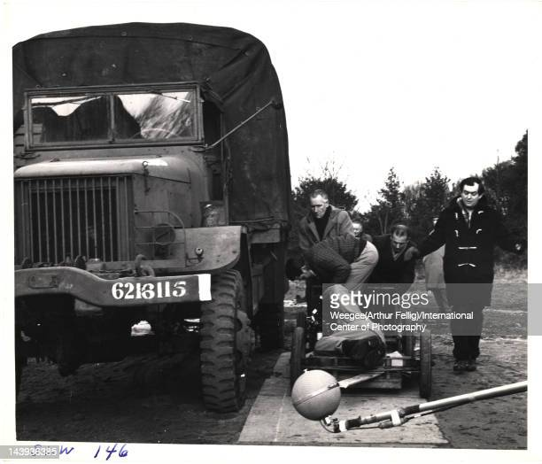 British film director Stanley Kubrick walks alongside a truck during the filming of 'Dr. Strangelove, Or How I Learned to Stop Worrying and Love the...