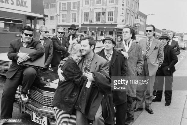 British film producer Alison Owen and her husband, British actor Keith Allen with cast members, British actors Robbie Coltrane, Adrian Edmondson,...