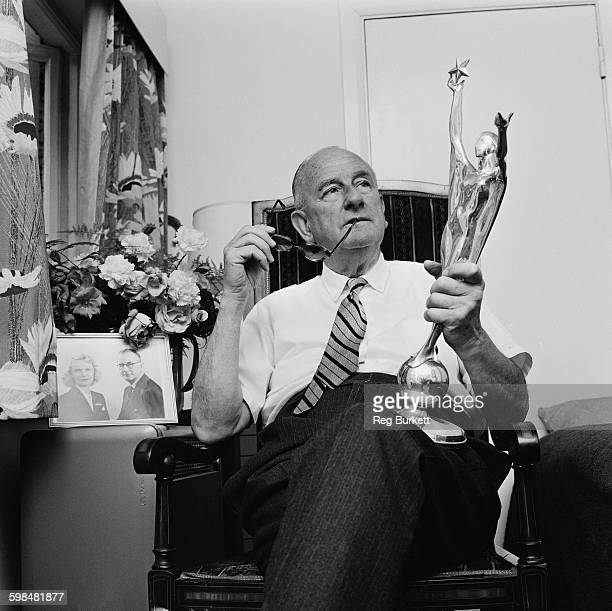 British film producer and director Herbert Wilcox pictured with one of his Daily Mail National Film Awards statuettes UK 25th July 1967 He married...