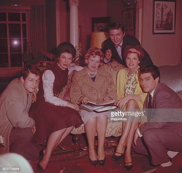British film producer Betty Box posed in centre with various actors from the film 'The Wild and the Willing in 1963 From left to right John Hurt...