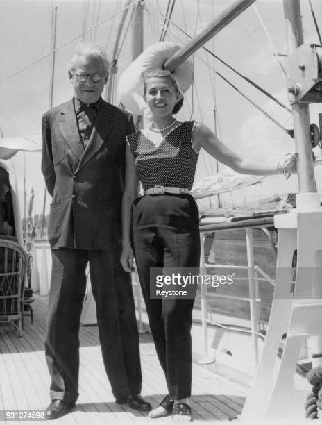 British film producer Sir Alexander Korda with his 25yearold fiancée Alexandra Boycun on board his yacht 'Elsewhere' at Antibes' France 5th June 1953