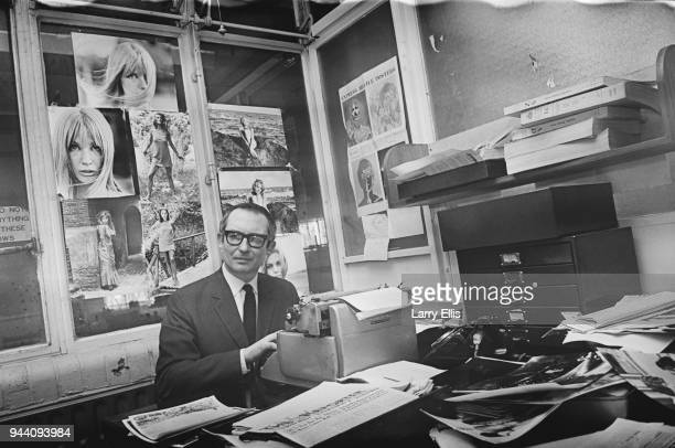British film scholar and Daily Express film critic Ian Christie in his office, UK, 5th April 1968.