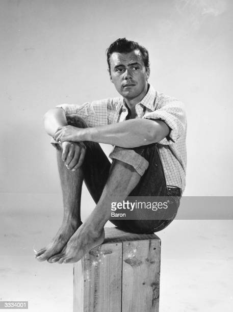 British film star and author Dirk Bogarde in casual wear