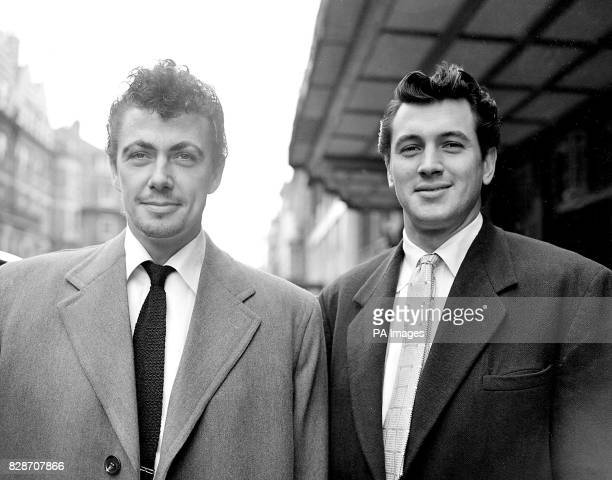 British film star Maxwell Reed and American film star Rock Hudson leaving their London hotel for Jersey where they go on location for filming...
