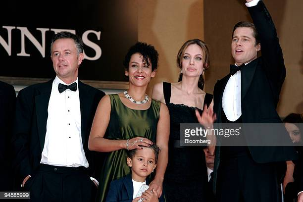 British filmmaker Michael Winterbottom left and author Mariane Pearl with son Adam center left attend the premiere for the film A Mighty Heart with...