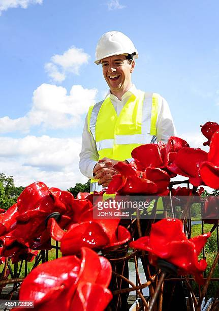 British Finance Minister George Osborne is pictured as he visits the construction of the iconic poppy sculpture entitled 'Wave' ahead of its public...
