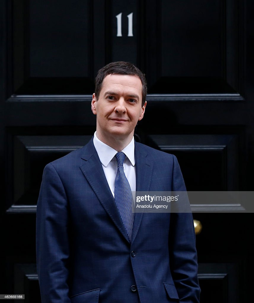 British Finance Minister George Osborne, welcomes Greece's new Finance Minister Yanis Varoufakis outside number 11 Downing Street in central London on February 2, 2015.