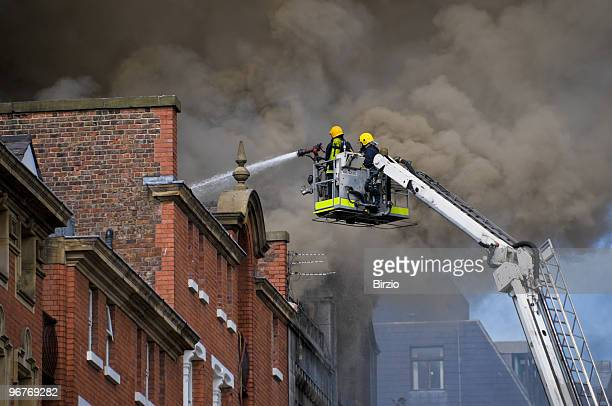 british firemen in action (close) - rescue services occupation stock photos and pictures