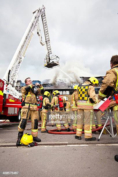 British firemen with protective clothing and breathing equipment at blaze