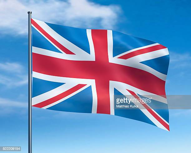 british flag against cloudy sky - british flag stock pictures, royalty-free photos & images